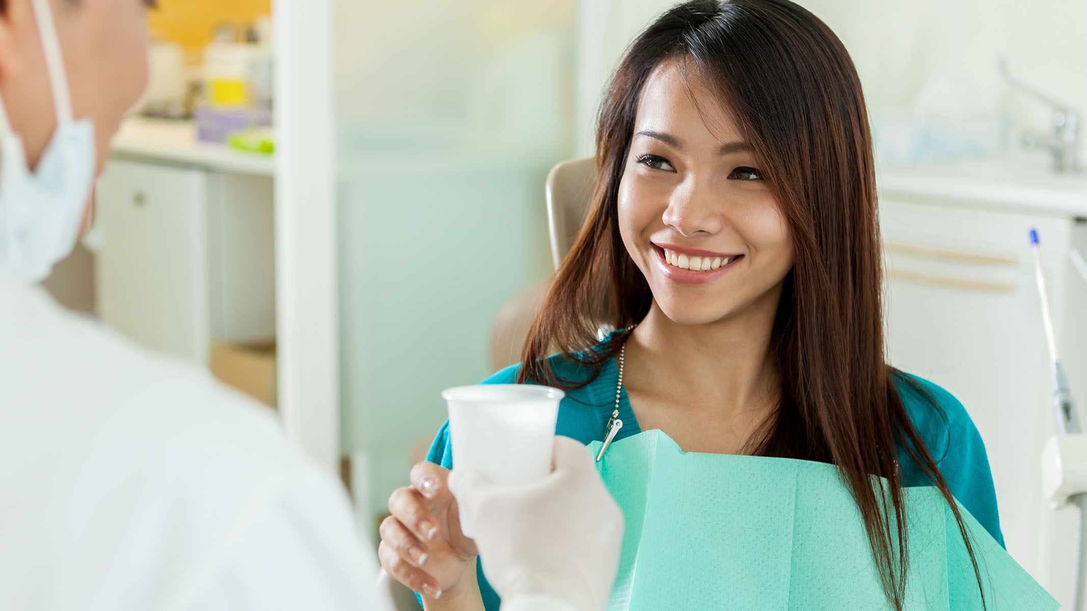 Young woman smiling at dentist