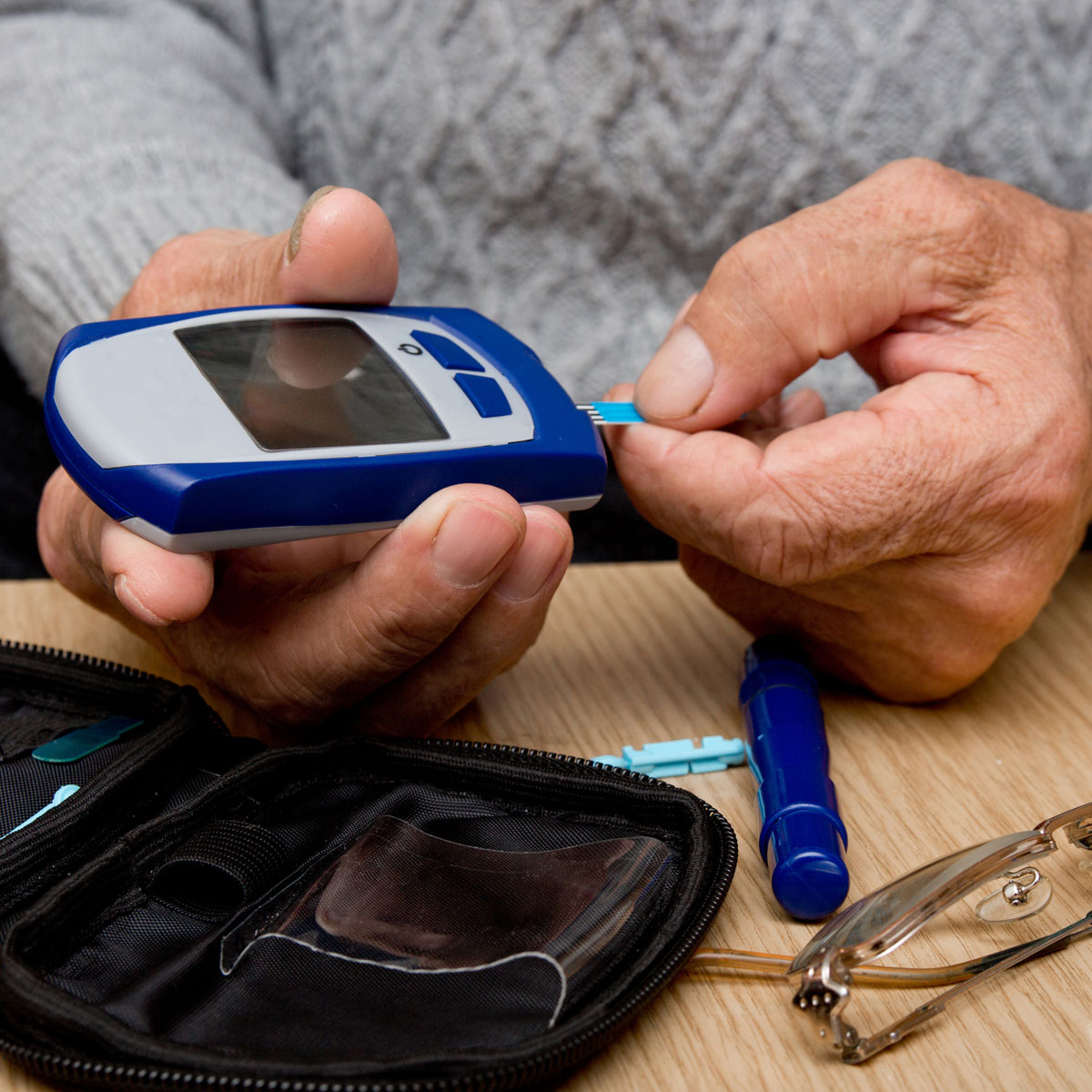 A patient tests their blood sugar levels.