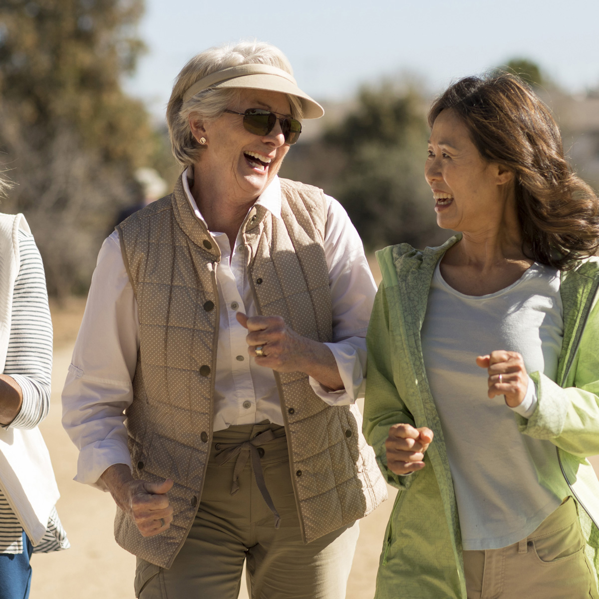 Smiling senior women walking outdoors