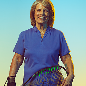 Patricia Thieman holds her raquetball racket.