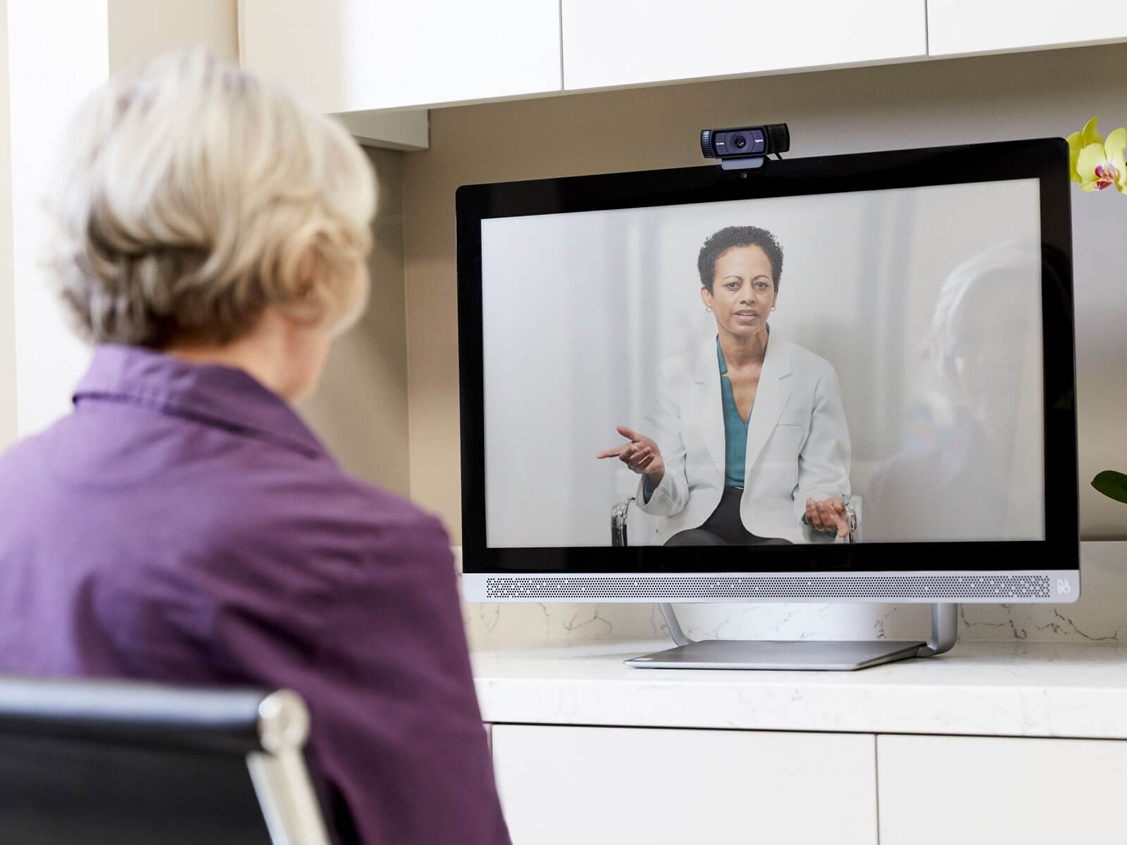 A woman receives medical advice from a secure visit with a doctor using Humana's telemedicine benefit.