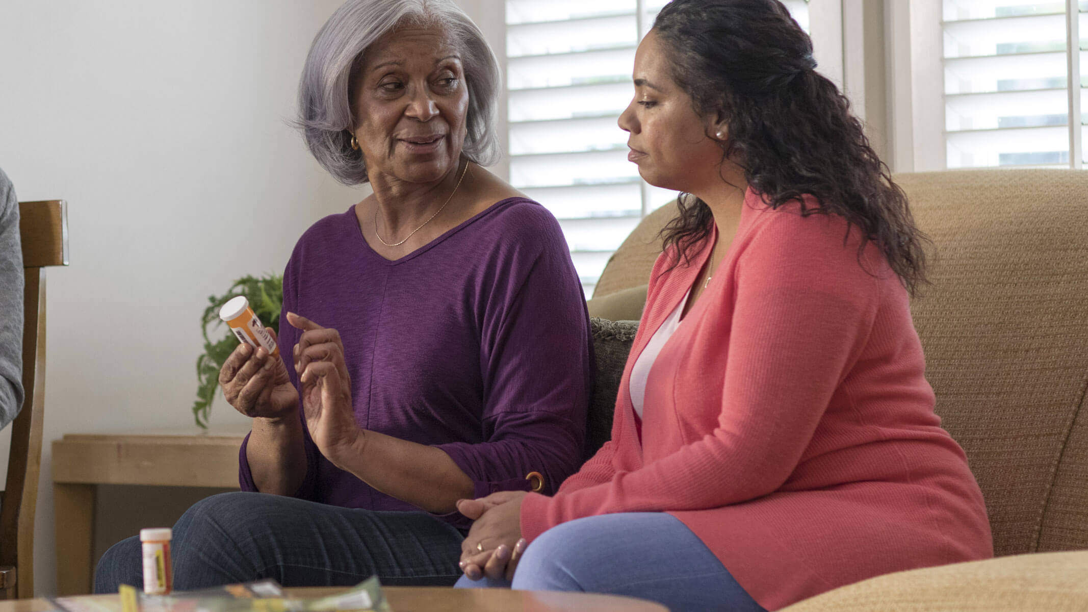 Woman with caregiver discussing prescription