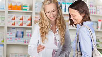 Pharmacist and woman getting medication