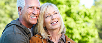 Vital older couple with great smiles outdoors
